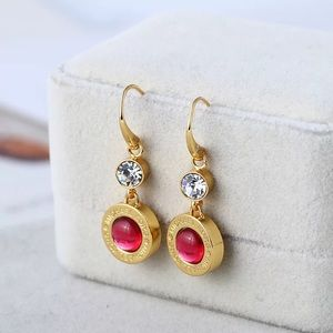 Michael Kors with pink stone earrings